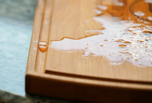 wood cutting board with juice groove, cutting board juice groove, juice groove benefits, butcher block juice groove, butcher block boards